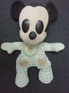 Baby Mickey Mouse wearing a bib