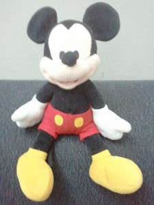 """""""Papa"""" Mickey Mouse sitting on top of couch"""