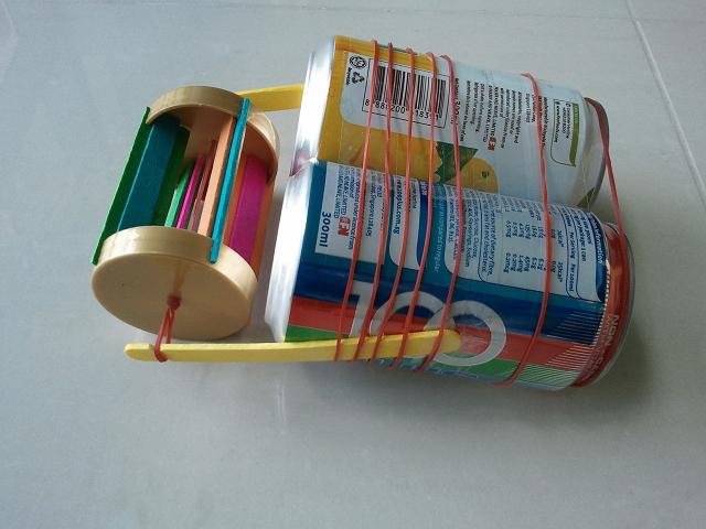 Initial prototype of paddle-wheel boat, made from drink cans and constructed paddle-wheel unit
