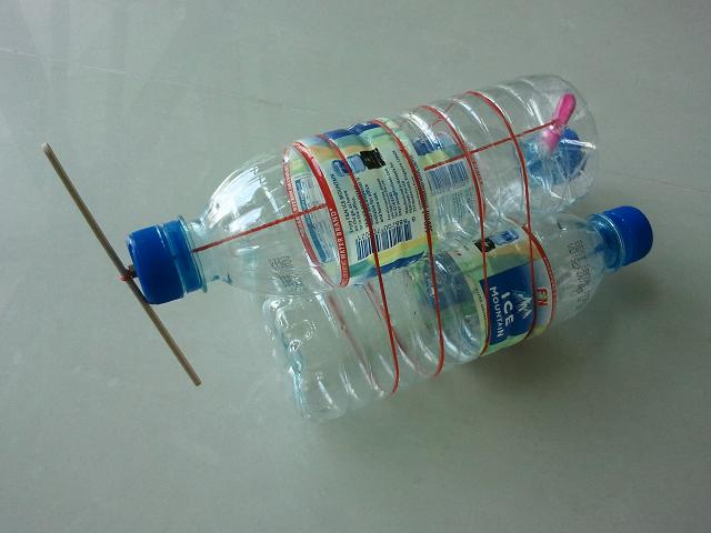 Propeller boat made from plastic bottles, rubber bands and ice cream stick